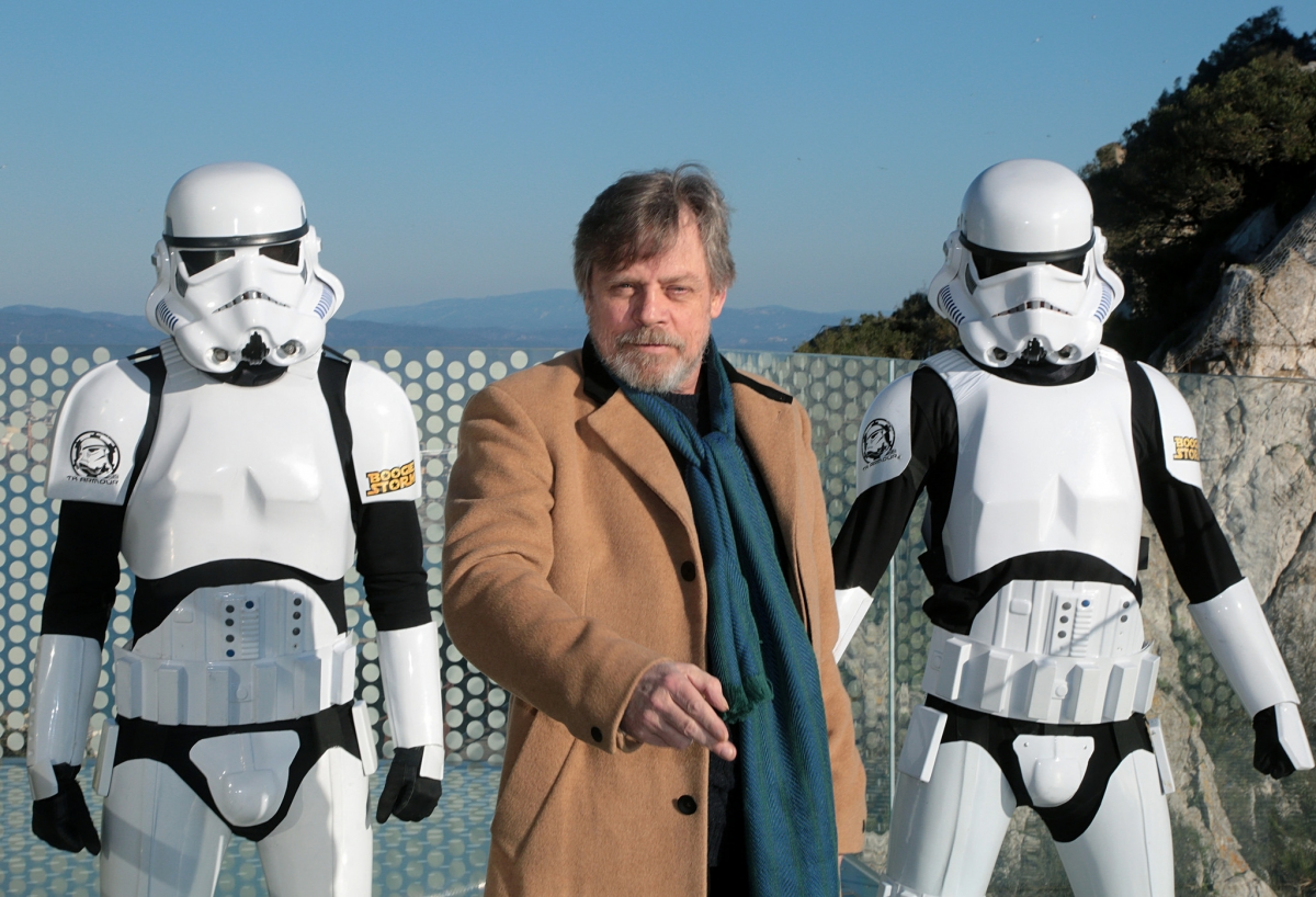 Mark Hamill takes the first steps on the Gibraltar Skywalk, flanked by members of Boogie Storm