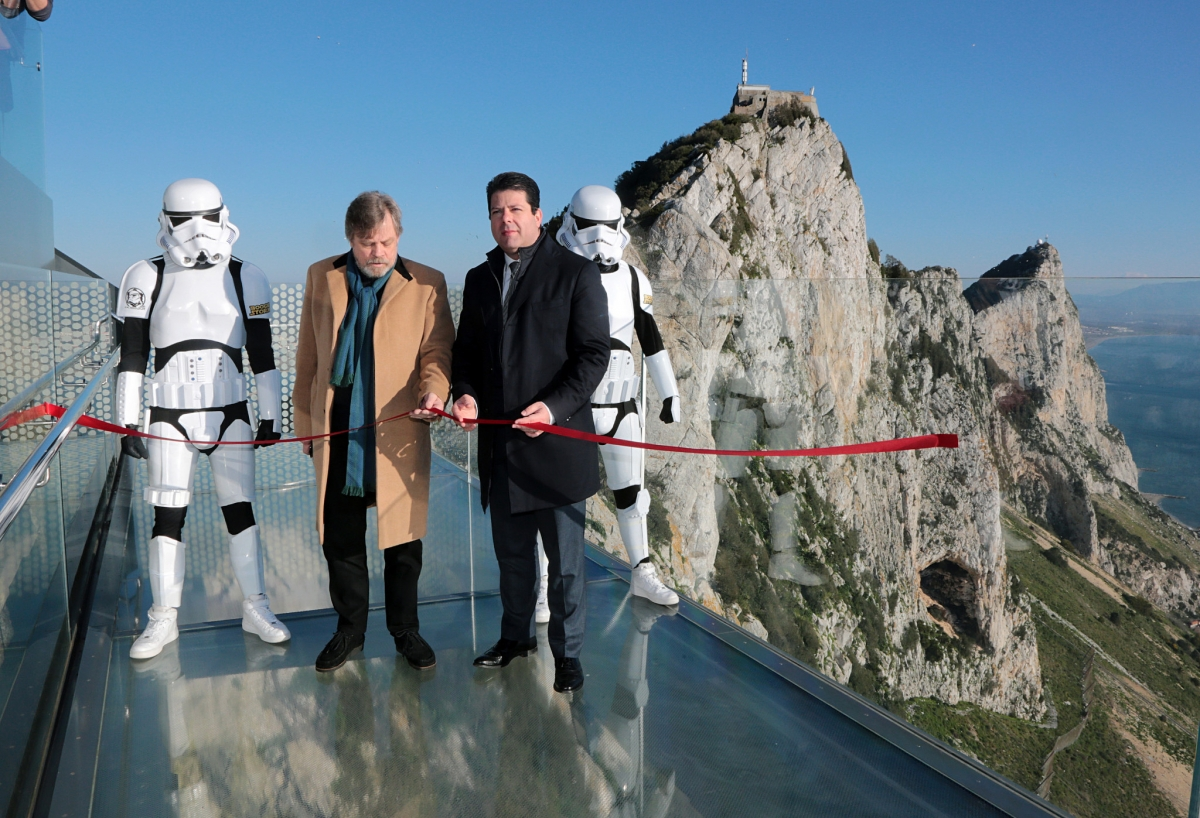 Mark Hamill cuts the red ribbon with a 'lightsaber'